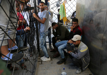 Palestinians react at a hospital following an explosion in the southern Gaza Strip