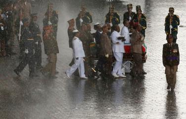 Winnie Madikizela-Mandela's coffin is taken from the Orlando stadium during her funeral service in Soweto