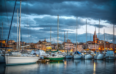 Dramatic sky over Alghero harbor at sunset