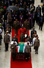 Family and officials follow Winnie Madikizela-Mandela's coffin as it is taken from the Orlando stadium after her funeral service in Soweto