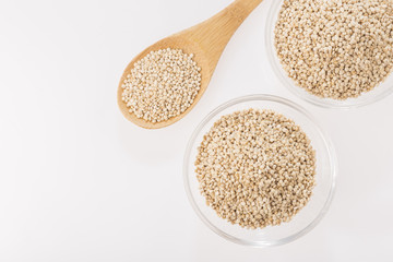 Quinoa grains in bowl isolated on white background, Chenopodium quinoa