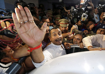 Kuldeep Singh Sengar, a legislator of Uttar Pradesh state from India's ruling BJP, reacts as he leaves a court after he was arrested on Friday in connection with the rape of a teenager, in Lucknow