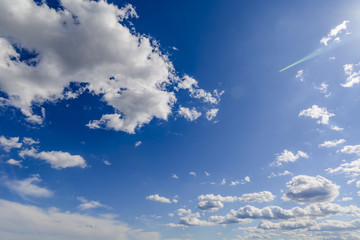 Sunny blue sky with clouds  in spring time .