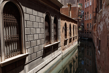 Typical view of a canal of Venice. Very narrow distance between buildings