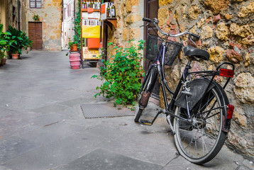 Bike in a alley of Pienza, Siena district, Tuscany, Italy, Europe.