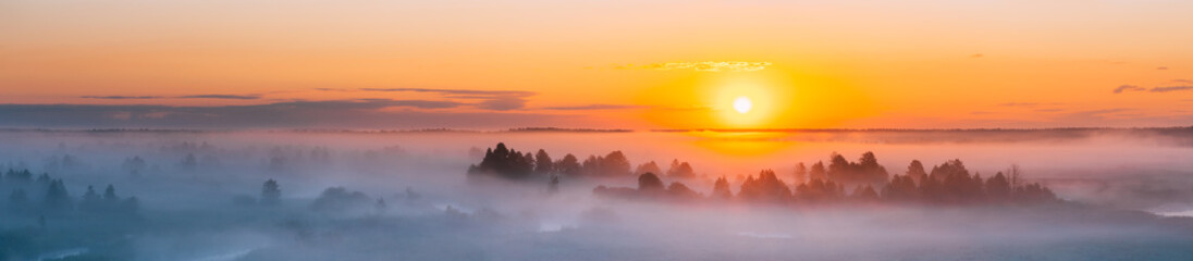 Amazing Sunrise Over Misty Landscape. Scenic View Of Foggy Morning