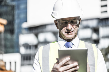 Construction manager controlling building site and tablet device