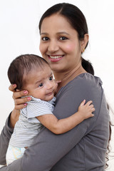 Cheerful mother holding newborn baby