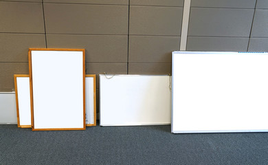White boards in the office leaning on cubicle