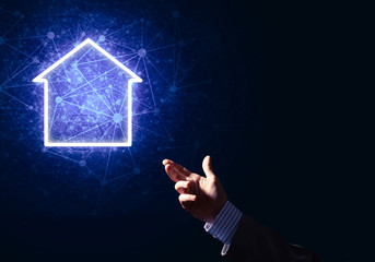 Conceptual image with hand pointing at house or main page icon o