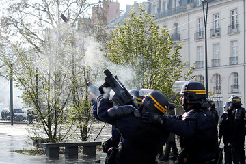 French CRS riot police fire tear gas during clashes with protesters at a demonstration in Nantes