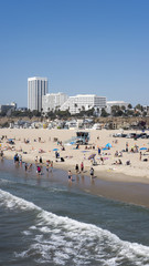 View from Santa Monica Pier towards the northern part of the beach, and resort with tourists enjoying a sunny day, Santa Monica State Beach, Los Angeles, California, USA
