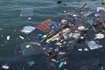 Garbage floats in the sea, plastic, styrofoam, bottles, bags. Environmental pollution