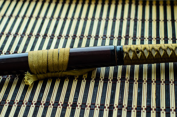 Japanese sword katana on bamboo mat