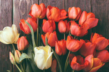 bouquet of red tulips on a wooden background, tulips close-up