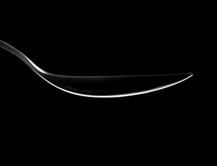 Spoon outline highlight om a black abstract background