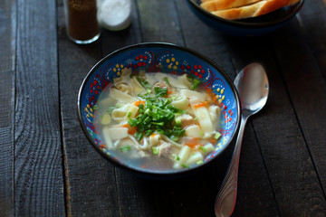 soup lagman on wooden background