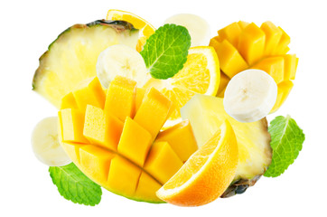 Flying mango, orange, pineapple and banana with mint leaves