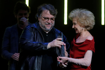 Spanish actress Marisa Paredes gives a trophy to Mexican director Guillermo del Toro during the ceremony of honouring him with Malaga-Sur award for lifetime achievements during the 21st Festival de Malaga Cine Espanol in Malaga