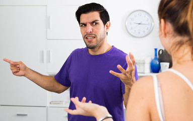 Angry man in quarrel with girl