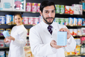 Smiling specialist who is holding medicines