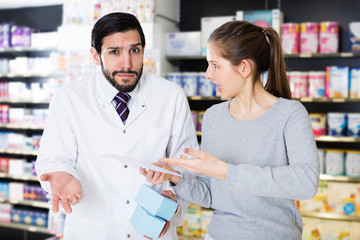 Outraged woman client in pharmacy