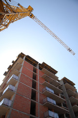 Construction site with cranes on sky background. Construction of a residential multi-storey building. New residential area
