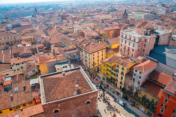 Aerial view of the amazing Verona old town with orange rooftops, main street and city skyline.