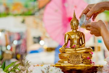 sprinkle water onto a Buddha image,  Songkran Festival