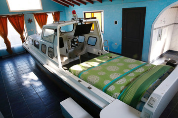 """A boat with a bed is seen inside a room at the Motel """"Bahia"""" in Concon."""