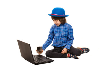 Small elegant boy with laptop and smart phone