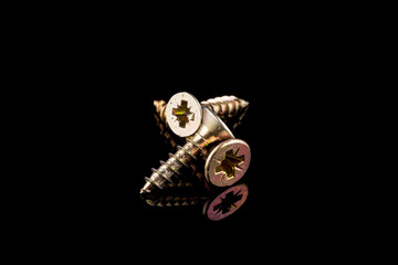 Screws on black background