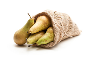 Ripe  Conference pears in sakcloth bag isolated on white