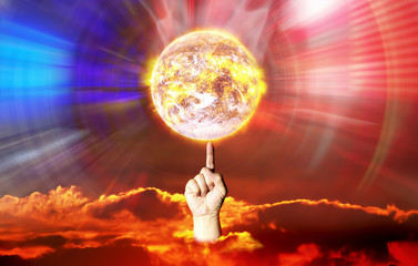 Finger spin hot earth shown manipulation of control power cause crisis problem .Image of earth and sun furnished by NASA.