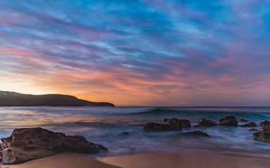 Dawn Seascape with Rocks and Clouds