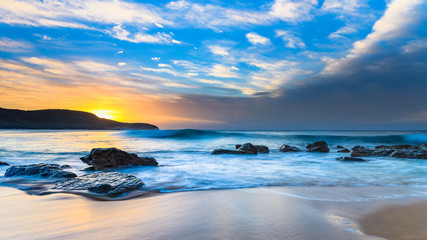 Blue Sunrise Seascape with Rocks and Clouds