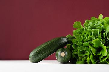 Rich green vegetables on modern exquisite marsala background.