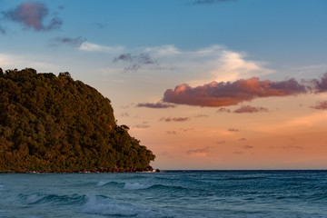 Sunset at the Lazy. Waves are breaking on the shore. Tropical Island, Koh Rong Sanloem. Cambodia, asia.