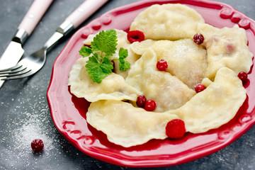 Berry fruit dumplings dessert, homemade sweet dumplings