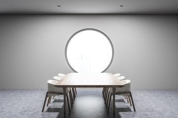 Gray dining room interior, round window