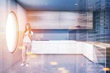 Gray round window kitchen, countertops toned