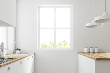 White kitchen with a window