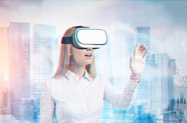 Blonde businesswoman VR glasses city
