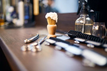 Barber tools lying on the table at barber shop. Barber background
