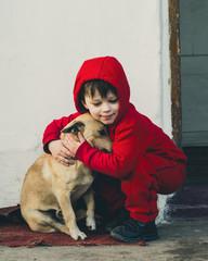 Two best friends portrait, little boy hugs a dog