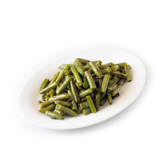 Green beans boiled on a white plate. Isolated