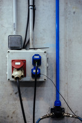 Electricity plugs in a mechanical garage