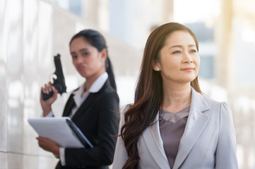 Middle Asian employee is not satisfied with the manager and thinking of hurting by firearms, unhappy to work with her manager.