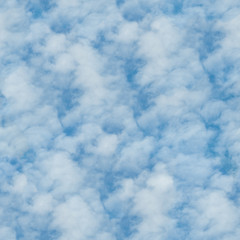 seamless texture of clouds on a blue sky background