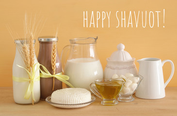 image of dairy products over wooden background. Symbols of jewish holiday - Shavuot.